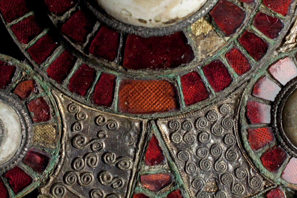 Photo of the garnet inlaid cloisonné composite disc brooch.