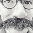 Black and white photo of a man with a very big moustache